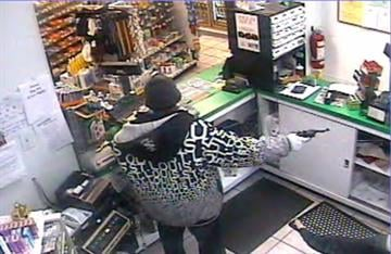 Surveillance photo from a robbery at a Sinclair gas station in Florissant By Afton Spriggs