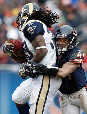 St. Louis Rams running back Steven Jackson (39) is tackled by Chicago Bears safety Kevin Payne (44) during the first half of an NFL football game in Chicago, Sunday, Dec. 6, 2009. (AP Photo/Nam Y. Huh) By Nam Y. Huh