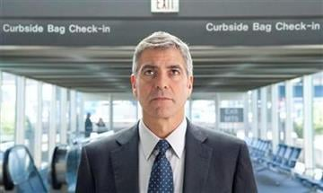 """In this film publicity image released by Paramount, George Clooney portrays Ryan Bingham in a scene from """"Up in the Air."""" (AP Photo/Paramount Pictures, Dale Robinette) By Dale Robinette"""