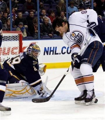 St. Louis Blues goalie Ty Conklin (29) watches as Edmonton Oilers' Sam Gagner (89) tries to control the loose puck with his skates in the first period of an NHL hockey game, Friday, Dec. 11, 2009, in St. Louis.(AP Photo/Tom Gannam) By Tom Gannam