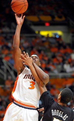 Illinois' Brandon Paul, left, shoots while being guarded byWestern Michigan's Mike Douglas during their NCAA college basketball game at the Assembly Hall in Champaign, Ill., on Sunday, Dec. 13, 2009. (AP Photo/Robin Scholz) By Robin Scholz