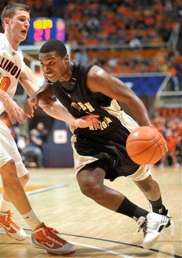 Western Michigan's Demetrius Ward drives into Illinois' Bill Cole during their NCAA college basketball game in Champaign, Ill., on Sunday, Dec. 13, 2009. (AP Photo/Robin Scholz) By Robin Scholz