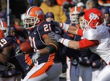 Illinois' Jason Ford (21) breaks down the field against Fresno State's Travis Brown during the first half of an NCAA college football game in Champaign, Ill., Saturday, Dec. 5, 2009. (AP Photo/Seth Perlman) By Seth Perlman