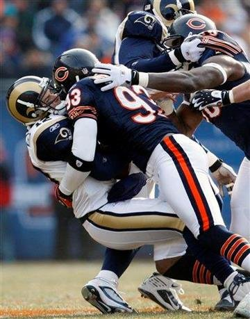 St. Louis Rams quarterback Kyle Boller (12) is sacked by Chicago Bears defensive end Adewale Ogunleye (93) during the first half of an NFL football game in Chicago, Sunday, Dec. 6, 2009. (AP Photo/Nam Y. Huh) By Nam Y. Huh