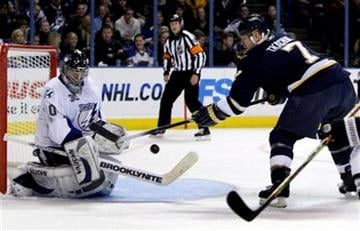 Tampa Bay Lightning goalie Antero Niittymaki, of Finland, makes a save on a shot by St. Louis Blues' Keith Tkachuk, right, during the second period of an NHL hockey game Friday, Dec. 18, 2009, in St. Louis. (AP Photo/Jeff Roberson) By Jeff Roberson