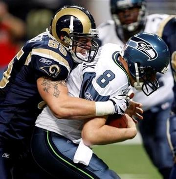 Seattle Seahawks quarterback Matt Hasselbeck, right, is sacked for a 7-yard loss by St. Louis Rams linebacker James Laurinaitis during the first quarter of an NFL football game Sunday, Nov. 29, 2009, in St. Louis. (AP Photo/Tom Gannam) By Tom Gannam