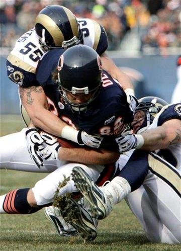 St. Louis Rams linebacker James Laurinaitis (55) and David Vobora, right, tackle Chicago Bears tight end Greg Olsen (82) during the first half of an NFL football game in Chicago, Sunday, Dec. 6, 2009. (AP Photo/M. Spencer Green) By M. Spencer Green