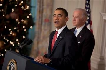 President Barack Obama, accompanied by Vice President Joe Biden, speaks in the State Dining Room of the White House in Washington, Thursday, Dec. 24, 2009, after the Senate passed  the health care reform bill. (AP Photo/Evan Vucci) By Evan Vucci