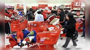 Early morning shoppers take advantage of a sale at Target in Colma, Calif., Saturday, Dec. 26, 2009. (AP Photo/Russel A. Daniels) By Russel A. Daniels