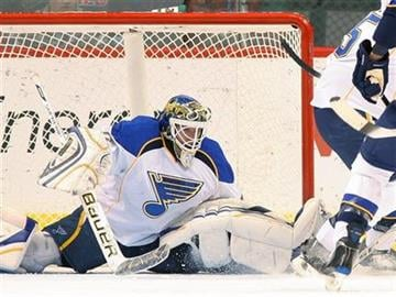 St. Louis Blues goalie Chris Mason reaches for the puck against the  Minnesota Wild in the first period of their NHL hockey game in St. Paul, Minn., Saturday, Dec. 26, 2009. (AP Photo/Andy King) By Andy King
