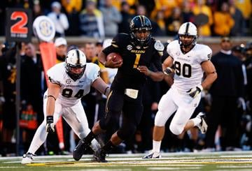 COLUMBIA, MO - OCTOBER 06:  Quarterback James Franklin #1 of the Missouri Tigers carries the ball during the game against the Vanderbilt Commodores on October 6, 2012 in Columbia, Missouri.  (Photo by Jamie Squire/Getty Images) By Jamie Squire