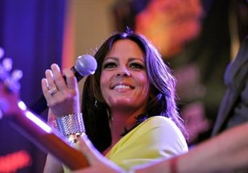 LAS VEGAS, NV - APRIL 01:  Singer Sara Evans performs onstage during the Academy of Country Music concerts on Fremont at the Fremont Street Experience on April 1, 2011 in Las Vegas, Nevada.  (Photo by Jerod Harris/Getty Images) By Jerod Harris