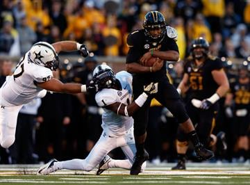 COLUMBIA, MO - OCTOBER 06:  Quarterback James Franklin #1 of the Missouri Tigers evades safety Kenny Ladler #1 of the Vanderbilt Commodores during the game on October 6, 2012 in Columbia, Missouri.  (Photo by Jamie Squire/Getty Images) By Jamie Squire