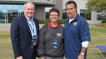 From (L to R): Mark Bass, vice president and general manager for Boeing's Maintenance, Modifications & Upgrades division, Christine Trotter, development director, USO of Missouri, and Jeff Fisher, Rams Head Coach. By Belo Content KMOV