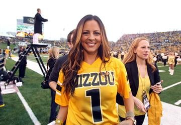 Country singer Sara Evans leaves the field after singing the National Anthem before the Alabama- Missouri football game at Faurot Field in Columbia, Missouri on October 13, 2012.   UPI/Bill Greenblatt By BILL GREENBLATT