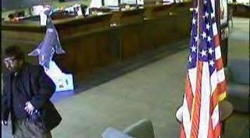"""Police say surveillance photos show a bank robbery suspect who yelled, """"Go Cards!"""" By Dan Mueller"""