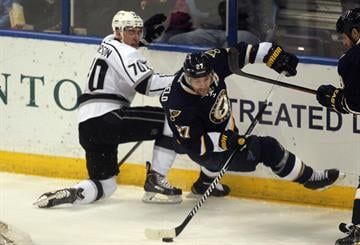 St. Louis Blues Alex Pietrangelo tries to keep his balance as he works the puck away from Los Angeles Kings Tanner Pearson in the first period at the Scottrade Center in St. Louis on December 16, 2014.    UPI/Bill Greenblatt By BILL GREENBLATT