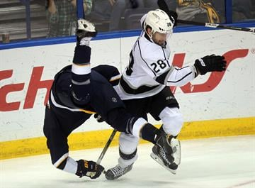 St. Louis Blues David Backes is upended by Los Angeles Kings Jarret Stoll in the first period at the Scottrade Center in St. Louis on December 16, 2014.    UPI/Bill Greenblatt By BILL GREENBLATT