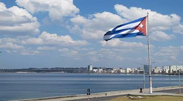 The Cuban flag flies along a Havana beach. By Stephanie Baumer