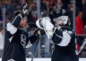 LOS ANGELES, CA - DECEMBER 18:  Jake Muzzin #6 and Jonathan Quick #32 of the Los Angeles Kings celebrate a 6-4 win over the St. Louis Blues at Staples Center on December 18, 2014 in Los Angeles, California.  (Photo by Harry How/Getty Images) By Harry How