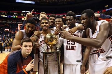 Members of the Illinois mens basketball team gather around the winners trophy after defeating the Missouri Tigers 62-59 in the annual Braggin Rights game at the Scottrade Center in St. Louis on Decmeber 20, 2014.     UPI/Bill Greenblatt By BILL GREENBLATT