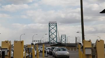 Cars approach the primary entry lanes to the U.S. at the Ambassador Bridge in Detroit, Michigan. By Stephanie Baumer