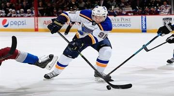 at Pepsi Center on December 13, 2014 in Denver, Colorado. The Blues defeated the Avalanche 3-2 in overtime. By Doug Pensinger
