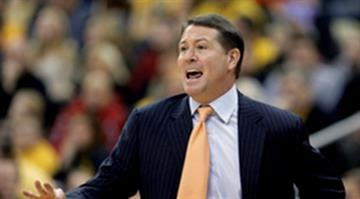 Oklahoma State coach Travis Ford talks to his players during the first half of an NCAA college basketball game against Missuouri Tuesday, Dec. 30, 2014, in Kansas City, Mo. (AP Photo/Charlie Riedel) By Charlie Riedel