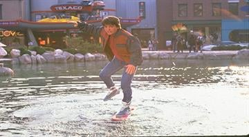 "In the 1989 film ""Back to the Future II,"" Marty McFly traveled to Oct. 21, 2015, a future with flying cars, auto-drying clothes and shoes that lace automatically. By Stephanie Baumer"