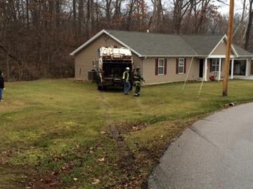 A trash truck crashed into a home in the 50 block of Lillian Drive Friday morning. By Stephanie Baumer