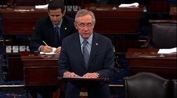 Sen. Harry Reid speaks on the US Senate floor after Senate passed a measure to avert going over the fiscal cliff early Tuesday morning, January 1, 2013. By Stephanie Baumer