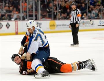 ANAHEIM, CA - JANUARY 02:  Ryan Reaves #75 of the St. Louis Blues fights Clayton Stoner #3 of the Anaheim Ducks to the ice during the first period at Honda Center on January 2, 2015 in Anaheim, California.  (Photo by Harry How/Getty Images) By Harry How
