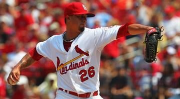 ST. LOUIS, MO - JULY 7: Starter Kyle Lohse #26 of the St. Louis Cardinals pitches against the Miami Marlins at Busch Stadium on July 7, 2012 in St. Louis, Missouri. (Photo by Dilip Vishwanat/Getty Images)