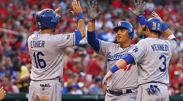 ST. LOUIS, MO - JULY 23: Luis Cruz #47 of the Los Angeles Dodgers is congratulated after hitting a three-run home run against the St. Louis Cardinals at Busch Stadium on July 23, 2012 in St. Louis, Missouri. (Photo by Dilip Vishwanat/Getty Images)