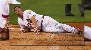 ST. LOUIS, MO - JULY 24: Lance Berkman #12 of the St. Louis Cardinals reacts after being hit by a pitch against the Los Angeles Dodgers at Busch Stadium on July 24, 2012 in St. Louis, Missouri. (Photo by Dilip Vishwanat/Getty Images)