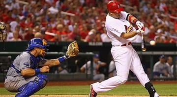 ST. LOUIS, MO - JULY 24: Allen Craig #21 of the St. Louis Cardinals hits a two-RBI double against the Los Angeles Dodgers at Busch Stadium on July 24, 2012 in St. Louis, Missouri. (Photo by Dilip Vishwanat/Getty Images)