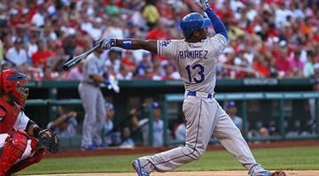 ST. LOUIS, MO - JULY 25: Hanley Ramirez #13 of the Los Angeles Dodgers hits a triple against the St. Louis Cardinals at Busch Stadium on July 25, 2012 in St. Louis, Missouri. (Photo by Dilip Vishwanat/Getty Images)