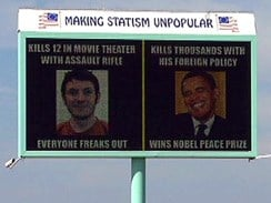 A billboard created by an Idaho libertarian group compares the foreign policy of President Obama with the violence of the alleged Aurora theater shooter.