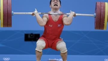 North Korea's Om Yun Chol competes during the men's 56-kg, group B, weightlifting competition at the 2012 Summer Olympics, Sunday, July 29, 2012, in London. (AP Photo)