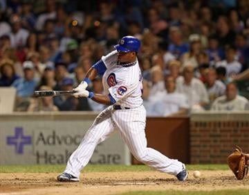 CHICAGO, IL - JULY 31: Luis Valbuena #24 of the Chicago Cubs swings and misses a pitch from A.J. Burnett of the Pittsburgh Pirates at Wrigley Field on July 31, 2012 in Chicago, Illinois.  (Photo by Jonathan Daniel/Getty Images) By Jonathan Daniel