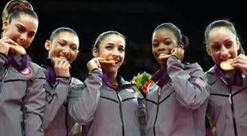 U.S. gymnasts McKayla Maroney, Kyla Ross, Alexandra Raisman, Gabrielle Douglas and Jordyn Wieber bite their gold medals at the artistic gymnastics women's team final at the 2012 Summer Olympics July 31, 2012, in London. By Belo Content KMOV