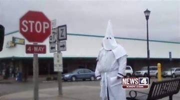 A Ku Klux Klan member hands out fliers in Park Hills, Missouri in February 2011. By KMOV Web Producer