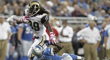 DETROIT - OCTOBER 10: Steven Jackson #39 of the St. Louis Rams runs through the tackle of Amari Spievey #42 of the Detroit Lions on October 10, 2010 at Ford Field in Detroit, Michigan. (Photo by Gregory Shamus/Getty Images) By Dan Mueller