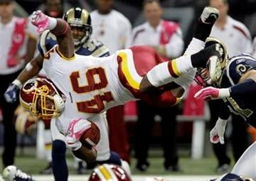 Washington Redskins running back Ryan Torain (46) flies through the air for a gain of 7-yards during the third quarter of the NFL football game against the St. Louis Rams Sunday, Oct. 2, 2011, in St. Louis. (AP Photo/Seth Perlman) By Seth Perlman