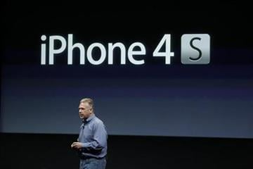 Apple Phil Schiller talks about iPhone 4S during announcement at Apple headquarters in Cupertino, Calif., Tuesday, Oct. 4, 2011.  (AP Photo/Paul Sakuma) By Paul Sakuma