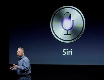 Apple's Phil Schiller talks about Siri with the new Apple iPhone 4S during an announcement at Apple headquarters in Cupertino, Calif., Tuesday, Oct. 4, 2011. (AP Photo/Paul Sakuma) By Paul Sakuma