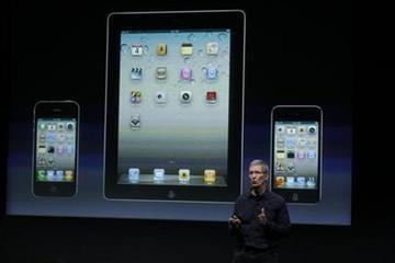 Apple CEO Tim Cook talk about iTouch, iPhone and iPad during announcement at Apple headquarters in Cupertino, Calif., Tuesday, Oct. 4, 2011.  (AP Photo/Paul Sakuma) By Paul Sakuma