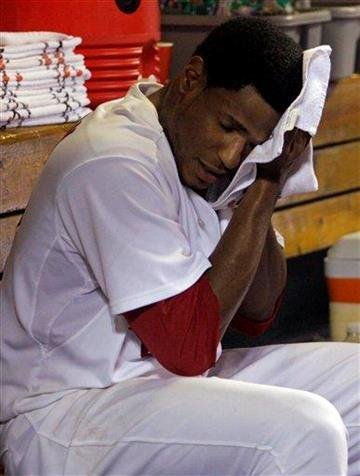 St. Louis Cardinals starting pitcher Edwin Jackson regroups in the dugout after giving up three runs in the third inning of a baseball game against the New York Mets, Tuesday, Sept. 20, 2011 in St. Louis.(AP Photo/Tom Gannam) By Tom Gannam
