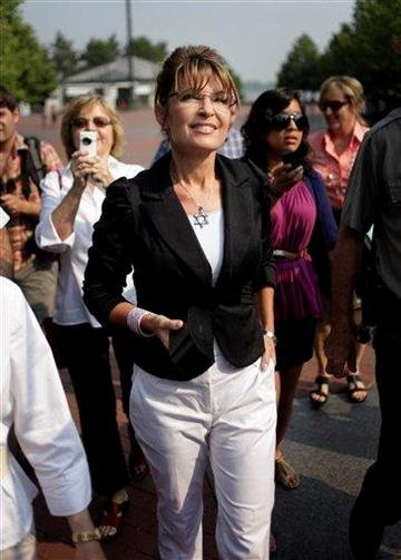 Sarah Palin looks up as she approaches the Statue of Liberty on Liberty Island in New York, Wednesday, June 1, 2011.  (AP Photo/Seth Wenig) By Seth Wenig