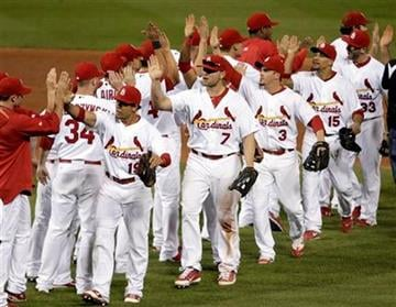 Members of the St. Louis Cardinals celebrate their 5-3 victory over the Philadelphia Phillies in Game 4 of baseball's National League division series Wednesday, Oct. 5, 2011, in St. Louis. (AP Photo/Tom Gannam) By Tom Gannam